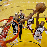 San Antonio Spurs power forward Tim Duncan (21) blocks a shot to the basket by Miami Heat shooting guard Ray Allen (34) during the second half of Game 6 in the NBA Finals basketball game, Tu …