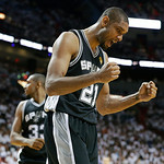 San Antonio Spurs forward Tim Duncan (21) reacts to play against the Miami Heat during the second half of Game 6 in their NBA Finals basketball series, Tuesday, June 18, 2013 in Miami. (AP P …