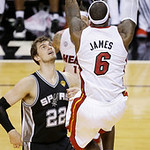 Miami Heat small forward LeBron James (6) dunks the ball against San Antonio Spurs center Tiago Splitter (22)during the second half of Game 6 of the NBA Finals basketball game, Tuesday, June …