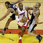 Miami Heat small forward LeBron James (6) works against San Antonio Spurs point guard Tony Parker (9) during second half of Game 6 of the NBA Finals basketball game, Wednesday, June 19, 2013 …