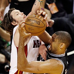 San Antonio Spurs power forward Tim Duncan (21) drives to the basket against Miami Heat shooting guard Mike Miller (13) during the second half of Game 6 of the NBA Finals basketball game, Tu …