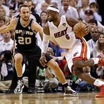 Miami Heat small forward LeBron James (6) moves the ball against San Antonio Spurs shooting guard Manu Ginobili (20) during the second half of Game 6 of the NBA Finals basketball game, Tuesd …