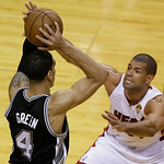 San Antonio Spurs shooting guard Danny Green (4) looks to pass as Miami Heat small forward Shane Battier (31) defends during the first half of Game 6 of the NBA Finals basketball game, Tuesd …