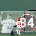 Los Angeles Angels center fielder Torii Hunter watches the home run ball hit by New York Yankees' Jorge Posada fly over the wall with a memorial for Angels pitcher Nick Adenhart during the e …