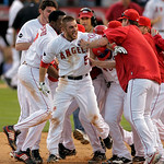 ** CORRECTS ANGELS PLAYER SCORED TO HOWIE KENDRICK  ** Los Angeles Angels' Jeff Mathis (5) is congratulated by his teammates after he hit a double to score Howie Kendrick  to beat the Yankee …