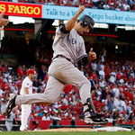 New York Yankees' Jorge Posada reacts after hitting a home run during the eighth inning of Game 3 of the American League Championship baseball series against the Los Angeles Angels Monday, O …