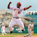 Los Angeles Angels' Howie Kendrick (47) reacts after scoring the game-winning run an a double by Jeff Mathis during the 11th inning of Game 3 of the American League Championship baseball ser …