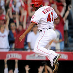 Los Angeles Angels' Howie Kendrick (47) reacts after scoring the game-winning run on a double by Jeff Mathis during the 11th inning of Game 3 of the American League Championship baseball ser …