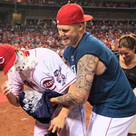 Cincinnati Reds starting pitcher Homer Bailey, left, gets his face covered by shaving cream by Mat Latos after Bailey threw a no-hitter against the San Francisco Giants in a baseball game, T …