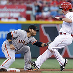 San Francisco Giants shortstop Brandon Crawford, left, tags out Cincinnati Reds' Ryan Hanigan, who tried to advance to second base on a bunt by Homer Bailey, who was tagged out in the fifth  …