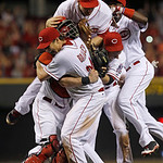 Cincinnati Reds starting pitcher Homer Bailey is mobbed after no-hitting the San Francisco Giants in a baseball game, Tuesday, July 2, 2013, in Cincinnati. (AP Photo/Al Behrman)