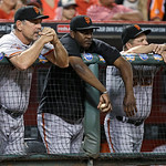 San Francisco Giants manager Bruce Bochy, left, watches from the dugout in the ninth inning of a baseball game against the Cincinnati Reds, Tuesday, July 2, 2013, in Cincinnati. Cincinnati w …
