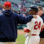 Cleveland Indians' Michael Bourn (24) is led off the field by manager Terry Francona, left, and assistant trainer Jeff Desjardins in the eighth inning of a baseball game against the Chicago  …