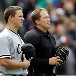 "Chicago White Sox starting pitcher Jake Peavy, left, and home plate umpire Cory Blaser stand for ""God Bless America"" during the seventh inning of a baseball game against the Cleveland Indian …"