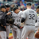 Chicago White Sox manager Robin Ventura, left, meets with starting pitcher Jake Peavy (44) and the infield on the mound in the seventh inning of a baseball game against the Cleveland Indians …
