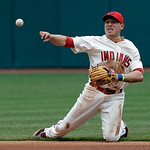 Cleveland Indians shortstop Asdrubal Cabrera throws from his knees but can't get Chicago White Sox's Jeff Keppinger at first in the fourth inning of a baseball game Sunday, April 14, 2013, i …