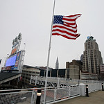 A United States flag flies at half mast for the victims of the Monday bombing at the Boston Marathon, on Tuesday, April 16, 2013, at Progressive Field in Cleveland before a baseball game bet …