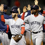Boston Red Sox's Dustin Pedroia, left, and Jackie Bradley Jr. celebrate after a 7-2 win over the Cleveland Indians in a baseball game Tuesday, April 16, 2013, in Cleveland. (AP Photo/Mark Du …