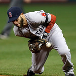 Boston Red Sox second baseman Dustin Pedroia smothers a ground ball by Cleveland Indians' Lonnie Chisenhall in the ninth inning of a baseball game Tuesday, April 16, 2013, in Cleveland. Bost …