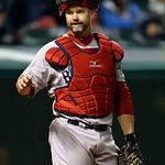 Boston Red Sox catcher David Ross looks to the dugout for a sign in he sixth inning of a baseball game against the Cleveland Indians Tuesday, April 16, 2013, in Cleveland. (AP Photo/Mark Dun …