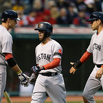 Boston Red Sox's Will Middlebrooks, left, congratulates Dustin Pedroia,  center, and Jacoby Ellsbury after they scored on a bases-loaded double by Mike Napoli in the second inning of a baseb …