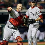 Boston Red Sox catcher David Ross throws to first to get Cleveland Indians' Nick Swisher as relief pitcher Clayton Mortensen watches in the seventh inning of a baseball game Tuesday, April 1 …