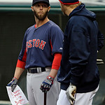 Boston Red Sox's Dustin Pedroia talks with Cleveland Indians' Mark Reynolds during batting practice before a baseball game Tuesday, April 16, 2013, in Cleveland. (AP Photo/Mark Duncan)