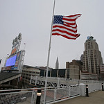The large American flag flies at half staff for the victims of the Boston bombing at Progressive Field in Cleveland before a baseball game between the Boston Red Sox and Cleveland Indians Tu …