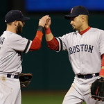 Boston Red Sox second baseman Dustin Pedroia, left, and right fielder Shane Victorino celebrate after a 6-3win over the Cleveland Indians in a baseball game Wednesday, April 17, 2013, in Cle …