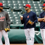 Cleveland Indians' Carlos Santana, left, Mike Aviles, center, and Ryan Raburn talk during batting practice before a baseball game against the Boston Red Sox Wednesday, April 17, 2013, in Cle …