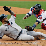 Cleveland Indians catcher Carlos Santana tags out Boston Red Sox's Mike Napoli trying to score from third on a ground ball by Jarrod Saltalamacchia in the first inning of a baseball game Wed …