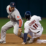 Cleveland Indians' Drew Stubbs (11) steals second base as Boston Red Sox shortstop Stephen Drew comes in with a late tag in the third inning of a baseball game Wednesday, April 17, 2013, in  …