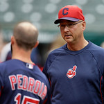 Cleveland Indians manager Terry Francona talks with Boston Red Sox second baseman Dustin Pedroia before a baseball game Wednesday, April 17, 2013, in Cleveland. (AP Photo/Mark Duncan)