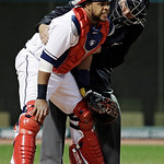 Home plate umpire Tim Timmons tends to Cleveland Indians catcher Carlos Santana after Santana was hit by a foul tip off the bat of Boston Red Sox's Dustin Pedroia in the fourth inning of a b …