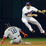 Cleveland Indians shortstop Asdrubal Cabrera avoids the slide of Boston Red Sox's Shane Victorino (18) after throwing to first to complete a double play on Mike Napoli in the eighth inning o …