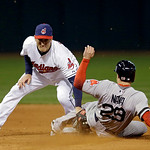 Cleveland Indians second baseman Cord Phelps, left, tags out Boston Red Sox's Daniel Nava attempting to steal second base in the sixth inning of a baseball game Wednesday, April 17, 2013, in …