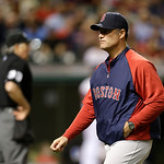 Boston Red Sox manager John Farrell walks back to the dugout after a pitching change in the eighth inning of a baseball game against the Cleveland Indians Thursday, April 18, 2013, in Clevel …