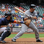 Cleveland Indians' Mark Reynolds, right, swings as Houston Astros catcher Jason Castro waits for the catch in the first inning of a baseball game Sunday, April 21, 2013, in Houston. (AP Phot …