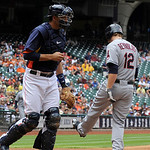 Cleveland Indians' Mark Reynolds (12) kicks at the dirt after striking out to end the top of the first inning as Houston Astros catcher Jason Castro heads to the dugout during a baseball gam …