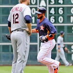 Houston Astros' Fernando Martinez , right, rounds the bases on a two-run homer as Cleveland Indians' Mark Reynolds (12) looks on  during an MLB American League  baseball game Sunday  April 2 …