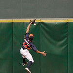 Houston Astros center fielder Justin Maxwell goes high on the centerfield wall but cannot make the catch giving Cleveland Indians' Yan Gomes a triple in the fourth inning of an MLB American  …