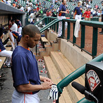 Houston Astros' Justin Maxwell puts his gloves in his pocket to leave the dugout after their 4-5 loss to the Cleveland Indians in a baseball game Sunday, April 21, 2013, in Houston. The Indi …
