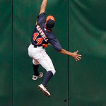 Houston Astros center fielder Justin Maxwell goes high on the centerfield wall but cannot make the catch giving Cleveland Indians' Yan Gomes a triple in the fourth inning of a baseball game  …