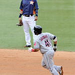 Cleveland Indians' Carlos Santana (41) rounds the bases past Houston Astros shortstop Marwin Gonzalez on a solo homer in the fifth inning of an MLB American League baseball game Sunday, Apri …