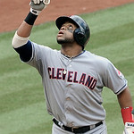 Cleveland Indians' Carlos Santana gestures as he crosses home plate on a solo homer against the Houston Astros in the fifth inning of an MLB baseball game Sunday, April 21, 2013, in Houston. …