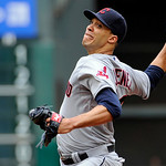 Cleveland Indians' Ubaldo Jimenez delivers a pitch against the Houston Astros in the first inning of a baseball game on Sunday, April 21, 2013, in Houston. (AP Photo/Pat Sullivan)