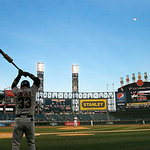 Cleveland Indians first baseman Nick Swisher stretches on deck during the first inning of a baseball game against the Chicago White Sox Monday, April 22, 2013, in Chicago. (AP Photo/Charles  …