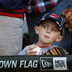 Luke Janosek, four, from Montgomery, Ill., waits by the Cleveland Indians' dugout for an autograph before a baseball game between the Chicago White Sox and the Indians Monday, April 22, 2013 …