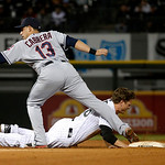 Cleveland Indians shortstop Asdrubal Cabrera (13) shows umpire Chad Fairchild the ball after taking a throw from catcher Carlos Santana and picking off Chicago White Sox's pinch runner Blake …