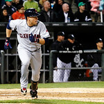 Cleveland Indians' Asdrubal Cabrera watches his two-RBI single off Chicago White Sox relief pitcher Matt Thornton, scoring Drew Stubbs and Michael Brantley, during the eighth inning of a bas …